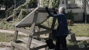 Diverged- Carol works on a solar panel- AMC, The Walking Dead