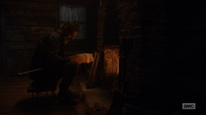 Here's Negan- Negan about to toss Lucille into the fireplace- AMC, The Walking Dead
