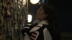 Acheron Part I- Yumiko sees a picture of herself on the wall of photos- AMC, The Walking Dead