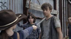 Out of the Ashes- Judith puts her sword to some kid's neck- AMC, The Walking Dead